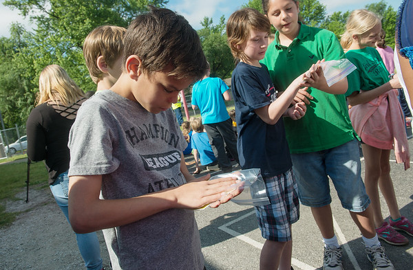 Globe/Roger Nomer<br /> Braydon Rainey, fifth grade, compares his hand to a kindergarten handprint from the Jefferson Elementary time capsule on Tuesday.