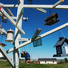 Globe/Roger Nomer<br /> Since their neighborhood lacked trees after the tornado, the homeowner at 2224 W. 26th built these artificial trees to hold their birdhouses.