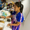 Globe/Roger Nomer<br /> Paw Shar, a Crowder sophomore from Guymon, Okla., serves Indian Samosas during Monday's International Food Festival at Crowder College.