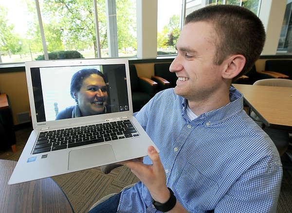 Jacob Harp video chats with his mother, Tammy Harp on Tuesday at Missouri Southern's Billingsley Student Center. The mother son duo are both set to graduate this MAy.<br /> Globe | Laurie Sisk