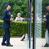 Globe/Roger Nomer<br /> Master Sgt. Elijah Wolfe, with the Civil Air Patrol, places a wreath at the Veterans Memorial at Mount Hope Cemetery on Monday.