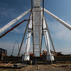Globe/Roger Nomer<br /> Workers with DeWitt Construction prepare to pour concrete at the base of the Branson Ferris Wheel on Tuesday.