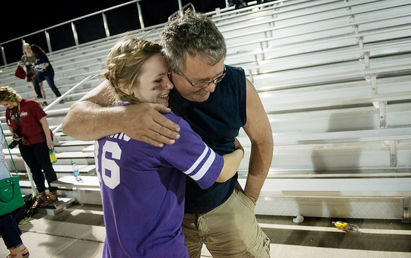 Globe/Roger Nomer<br /> After an exausting evening of football, Emily Huddleston hugs her father Mike. Through the support of her friends and family, Huddleston is graduating with a future full of promise after the tornado.