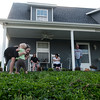 Globe/Roger Nomer<br /> Tamara Comer's granddaughters Mackenzie, 11, and Remington, 1, Palmer play on the front lawn of her rebuilt house on Kentucky Avenue on Thursday, April 21.