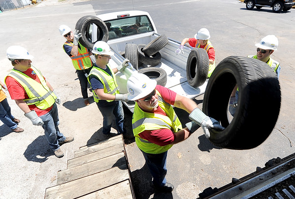 Empire District Electric employees load some of the estimated xxxx tires they collected on Friday during a free tire drop off at the Joplin Recycling Center. The tires will be sent to Kansas City and chopped into tire-derived fuel, which will be mixed with coal at the Asbury facility to produce electricity.<br /> Globe | Laurie Sisk