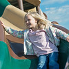 Globe/Roger Nomer<br /> Lily Gradd, 4, plays on a slide at Cunningham Park on Saturday evening.