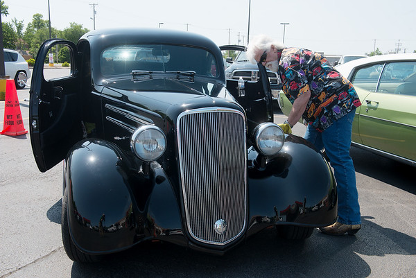 Globe/Roger Nomer<br /> Mike Shipley, Lowell, Ark., cleans his 1935 Chevy Master Sport Deluxe Coup on Friday at Price Cutter in Joplin. Shipley was on hand to give Richard Gray a membership to the Heartbeat of the Ozarks Classic Car Club.