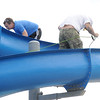 Crews ready the slides at Cunningham Park on Wednesday in preparation for the pool's opening on Saturday.<br /> Globe | Laurie Sisk