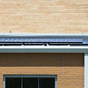 Globe/Roger Nomer<br /> Solar panels provide energy from the top of Greenfield High School.