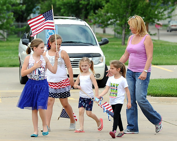 Loretta Smith, right, escorts children from her daycare on Tuesday at the Carson-Wall Funeral Home in Parsons to pay their respects to sailor Dale Pearce, who perished 75 years ago while serving with the Navy at Pearl Harbor. Pictured from the left: Payton Sanders, 9, Abby Klingman, 10, Taelyn Smith, 5 and Marlee Madl, 5.<br /> Globe | Laurie Sisk