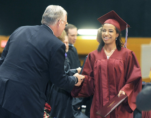 Joplin High School graduate Joy Aldridge is congratulated by Missouri Governor Jay Nixon during commencement ceremonies on Sunday at Leggett & Platt.<br /> Globe | Laurie Sisk