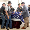 Pall bearers from the Coffeyville Post 20 American Legion Riders at Carson-Wall Fyneral Home in Parsons help transport the body of sailor Dale Pearce, who perished 75 years ago while serving with the Navy at Pearl Harbor.<br /> Globe | Laurie Sisk
