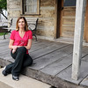 Ashley Scroggins sits outside an old cabin that is part of the Historic Walk/Run Tours Scroggins hosts in Neosho.<br /> Globe | Laurie Sisk