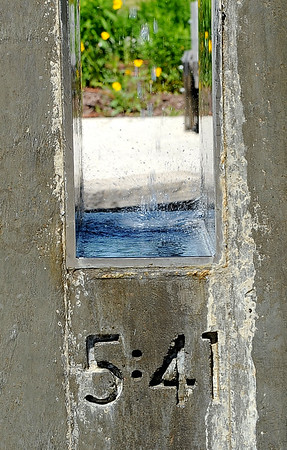 An etching in the masonry of a fountain at Cunningham Park marks the exact time the May 2011 tornado struck the park.<br /> Globe   Laurie Sisk
