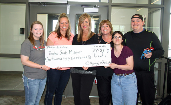 Photo Courtesy of St. Mary's Elementary<br /> (from left) Syndey Barlett, Kara Simon and Tracy Taylor from Easter Seals Midwest, Margie Black, Joycelynn Straw and Scottie Black present a check for $1,034 to Easter Seals Midwest from St. Mary's Elementary on Thursday, April 28. The money was raised by St. Mary's students over a month by dress-down days.