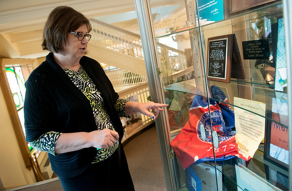 Globe/Roger Nomer<br /> Joplin City Clerk Barbara Hogelin talks about gifts and donations from the 2011 tornado on display at City Hall.
