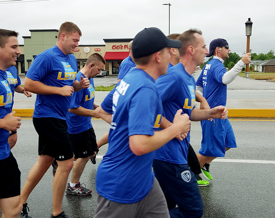 Photo Courtesy Joplin Police Department<br /> Joplin Police Officers run during the Special Olympics Missouri Law Enforcement Torch Run on Tuesday morning along Rangeline Road. The officers handed the torch off to the Webb City Police Department later in the day. The torch will eventually make its way to Springfield this Friday for the Special Olympics Opening Ceremony.