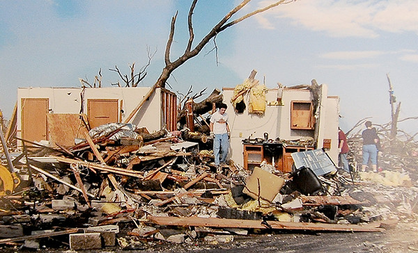 Courtesy photo<br /> A snapshot of the devastation the May 2011 torando brought to the Cut Loose Salon sits inside a large scrapbook of tornado related photographs on a shelf in the waiting area of the salon.