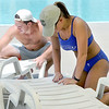 Ewert Pool manager Austin Ritter, left and lifeguard Lindsey Wood sanitize loungers on Wednesday in preparation for the pool's opening on Saturday.<br /> Globe | Laurie Sisk