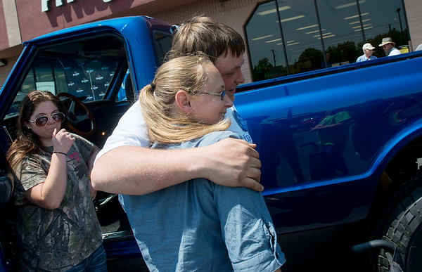 Globe/Roger Nomer<br /> Richard Gray gets a hug from his sister-in-law Crystal Baker after delivery of his newly restored truck on Friday at Price Cutter in Joplin.
