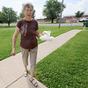 Meals on Wheels volunteer Margaret Merriweather delivers a hot lunch to a Columbus home on Wednesday.<br /> Globe | Laurie Sisk