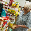 Globe/Roger Nomer<br /> Nicky Curran sorts canned goods at Crosslines on Tuesday.