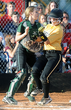 Diamond's Zoe Renfro scores Diamond's first run as College Heights catcher Courtney Bates awaits the throw during their Class1, District 11 semifinal game on Tuesday at Diamond.<br /> Globe | Laurie SIsk