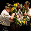 Globe/Roger Nomer<br /> Martin Dupslaff, left, and Master Sgt. Ken Griffing present the wreath during the Memorial Day ceremony at the Bicknell Center for the Arts on Monday.