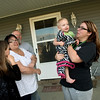 Globe/Roger Nomer<br /> Tamara Comer and Darren Wilkinson say their goodbyes to her daughter Samantha Palme and grandchildren Mackenzie, 11, and Remington, 1, on Thursday, April 21.