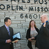 Globe/Roger Nomer<br /> Danny Anderson takes the oath of office administered by Brian Perron, left, manager of post office operations, as Anderson's wife Charlene holds the Bible on Wednesday at the Main Street Post Office.