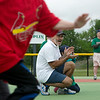 Globe/Roger Nomer<br /> Mark Norton cheers a runner home during a game on Saturday, April 30, at the Will Norton Miracle Field. Norton believes his son Will would have loved to volunteer at the field bearing his name.