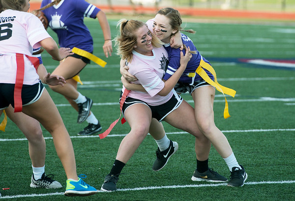 Globe/Roger Nomer<br /> Emily Huddleston blocks fellow senior Abigael Killinger during the Powderpuff Football game on Friday, May 6. Despite her injury, Huddleston has continued to be physically active in activities like cheerleading and track.