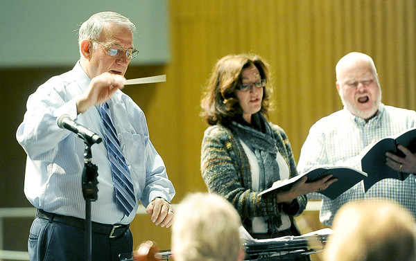 "Col. L. Bryan Shelburne Jr., former director of the U.S. Army Band, conducts the orchestra in preparation for a return performance of ""The Other Side of Storm,"" during rehearsal on Wednesday at Joplin High School. Also pictured are vocalists  Jennifer and Bjoern Arvidsson.<br /> Globe 
