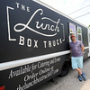 Entrepeneur Caleb Stiles stands beside The Lunchbox Truck on Wednesday in Carthage.<br /> Globe | Laurie Sisk