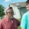 Globe/Roger Nomer<br /> Randy Crane, president of the Joplin Area Fuller Center, congratulates Eric Karraker on his new house on Monday.