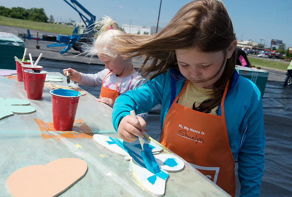 Globe/Roger Nomer<br />  Cousins Laken, 5, left, and Shaelyn, 6, Simpson, Joplin, paint butterflies on Saturday at Home Depot as part of Community Kaleidoscope event held by Joplin Proud. About 1,800 butterflies were available for painting, and participants got to take them home to be placed in their yards.
