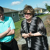 Globe/Roger Nomer<br /> Cindy Karraker holds back tears as she talks about what the new house will mean for her son Eric after Monday's check presentation.