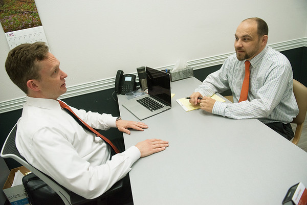 Globe/Roger Nomer<br /> Kurt Benecke, chief operating officer, left, and Marshall Miller, vice president of client services, talk Tuesday at The Law Store in the Joplin Seventh Street Walmart.