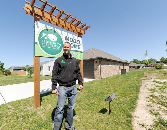 Daman Schuber, of Schuber Mitchell Homes, stands near one of his model homes in East Joplin.<br /> Globe | Laurie Sisk