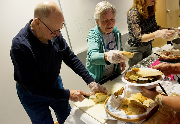 Globe/Roger Nomer<br /> Rodney and Sandy Peters, serve pieces of French Canadian Bread during Monday's International Food Festival at Crowder College. Sandy Peters teaches creative writing at Crowder.