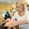 Cut Loose salon owner Dianna Collins works with a client at her salon.<br /> Globe | Laurie Sisk