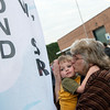Globe/Roger Nomer<br /> Carol Gibby kisses her grandson Ezekiel Gibby, 3, underneath a flag dedicated to her father, and Ezekiel's grandfather, Raymond Chew during Friday's Walk of Silence.