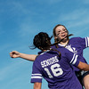 Globe/Roger Nomer<br /> Emily Huddleston greets a senior teammate with a flying chest bump during introductions for the Joplin High Powderpuff Football game on Friday, May 6. Huddleston was severely injured in the 2011 tornado as debris ripped her left leg.