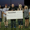 Globe/Roger Nomer<br /> (from left) Kevin Theilen, Chuck Brown, both with the Joplin High Booster Club, David Conrad and Whitney Herrod, with Rapha House, Melanie Gaudette and John Lopes, with the Booster Club, are present for a check presentation of $1,000 to Rapha House from proceeds of Joplin High's Powderpuff Football game on Friday at the school. The senior class voted on which organization would receive the funds.