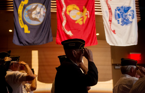 Globe/Roger Nomer<br /> Melvin Rupard, with the Frontenac American Legion Post 43, salutes during the Memorial Day ceremony at the Bicknell Center for the Arts on Monday.