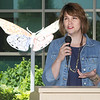 "Springdale, Ark. artist Vanessa Ryerse talks about the creation of Mercy Hospital's ""Spread Our Wings""  butterfly sculpture during unveiling ceremonies on Friday at the Hospital. Ryerse used broken dishes to form a mosaic in the colors of the Mercy Cross, with the broken pieces coming together to represent a unification of the community after the May 2011 tornado.<br /> Globe 