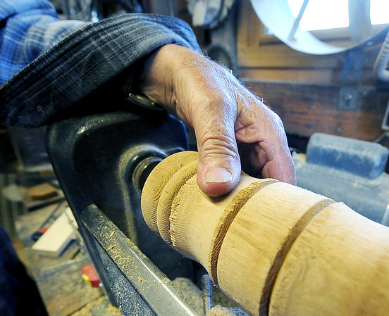 Eighty eight-year-old woodsmith Tom Rhoads tools detail into a template of a gavel on his lathe inside his workshop on Tuesday. Most items in his home made of wood were created by Rhoads.<br /> Globe | Laurie Sisk