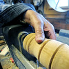 Eighty eight-year-old woodsmith Tom Rhoads tools detail into a template of a gavel on his lathe inside his workshop on Tuesday. Most items in his home made of wood were created by Rhoads.<br /> Globe   Laurie Sisk