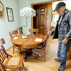 Eighty eight-year-old woodsmith Tom Rhoads stands next to a walnut table with caned chairs he crafted. Most items in his home made of wood were created by Rhoads.<br /> Globe | Laurie Sisk