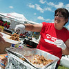 Globe/Roger Nomer<br /> Nicole Backerman, Carthage, serves as part of Operation BBQ Relief on Sunday at Cunningham Park.